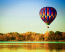 Colorful hot air balloon over lake