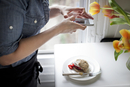 Woman photographing cake with smartphone
