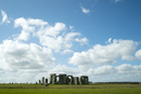 Mid distance view of Stonehenge on field against cloudy sky