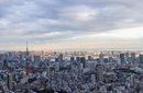 Aerial view of Tokyo Tower amidst city against cloudy sky