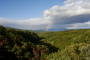 Scenic view of Hakkoda Mountain Range against rainbow and cloudy sky