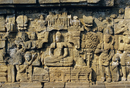 Relief carvings on frieze on outside wall of the Buddhist temple, Borobodur (Borobudur), Java, Indonesia