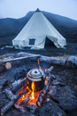 Boiling water pot over an open fire on a campsite and tipi on Tolbachik volcano, Kamchatka, Russia, Eurasia