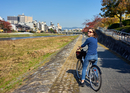Cycling along the bank of the Kamo River in autumn, Kyoto, Japan, Asia