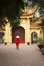 Girl wearing Ao Dai dress, Tran Quoc Pagoda, West Lake (Ho Tay), Hanoi, Vietnam (MR)