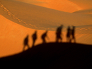Digital Composite Image Of Friends Walking On Desert During Sunset