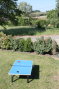High Angle View Of Table Tennis Table On Grassy Landscape