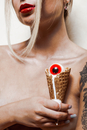 Midsection Of Young Woman Holding Ice Cream Cone