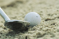 Sand wedge posed next to golf ball