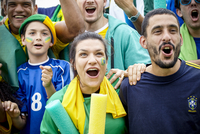 Brazilian football fans cheering at football match