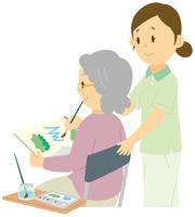 水彩画を描く老人女性と介護士 11002064306| 写真素材・ストックフォト・画像・イラスト素材|アマナイメージズ