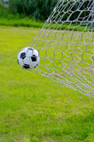 a Football Trapped in a Goal Net
