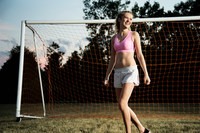 Girl by football goal