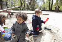 Children playing with sand in playground