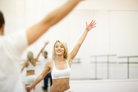 Young woman aerobic training in gym
