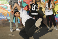 Young women in breakdancing freeze