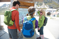 Tourists looking at information board, Independence Mine State Historical Park, Hatcher Pass, Matanuska Valley, Palmer, Alaska,
