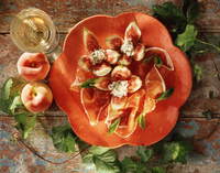 Mediterranean style food, parma ham, figs, soft cheese, peaches, glass of white wine, overhead view 11015282965| 写真素材・ストックフォト・画像・イラスト素材|アマナイメージズ