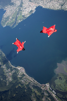Two wingsuit skydiver pilots team training and flying close together over lake, Locarno, Tessin, Switzerland 11015290956| 写真素材・ストックフォト・画像・イラスト素材|アマナイメージズ