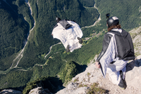 Wingsuit BASE jumper is flying down, filmed by another BASE jumper, Italian Alps, Alleghe, Belluno, Italy 11015290978| 写真素材・ストックフォト・画像・イラスト素材|アマナイメージズ