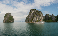 Cruise boat in waters of Ha Long Bay, Vietnam