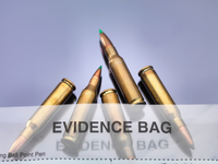 Bullets coming out of scene of crime forensic bag in a lab 11015323265| 写真素材・ストックフォト・画像・イラスト素材|アマナイメージズ