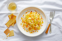 Spiralized yellow squash pasta with yellow cherry tomato, feta, orange pepper and a orange pepper coulis 11015333511| 写真素材・ストックフォト・画像・イラスト素材|アマナイメージズ