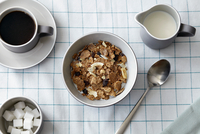 Cereal with dried fruit, coffee and milk jug, overhead view 11015340900| 写真素材・ストックフォト・画像・イラスト素材|アマナイメージズ