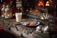 Cookies and milk, for Santa, left beside fireplace
