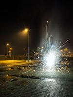 Fireworks going off in a car park, on new years eve, Heerenveen, Friesland, Netherlands
