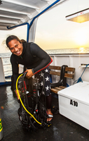 Man checking dive gear on board dive boat, Tubbataha Reefs Natural Park, Sulu Sea, Philippines 11015344743| 写真素材・ストックフォト・画像・イラスト素材|アマナイメージズ