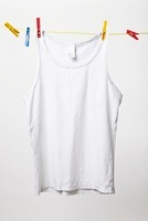 White tank top hanging on clothes line