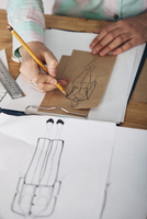 High angle view of female designer drawing sketch on paper at studio 11016036142| 写真素材・ストックフォト・画像・イラスト素材|アマナイメージズ