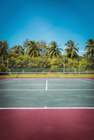 Tennis court against clear blue sky