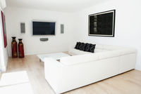 Sofas, television and wall art in modern living room