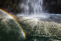 High angle view of rainbow over waterfall flowing into river 11018088110| 写真素材・ストックフォト・画像・イラスト素材|アマナイメージズ