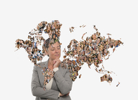 Pensive businesswoman behind global map of people 11018092716| 写真素材・ストックフォト・画像・イラスト素材|アマナイメージズ