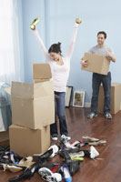 Couple Unpacking Shoes in New Home