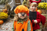 kids Dressed up as Pumpkin and Devil