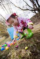 Little Girl Searching for Easter Eggs in the Park