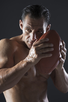 Portrait of Man with Football, Studio Shot