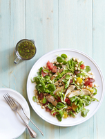 Overhead View of Tomato Bean Herb Salad with Chicken and Fresh Mixed Greens, Studio Shot