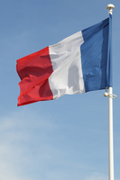 French Flag Blowing in Breeze, France 11030043863| 写真素材・ストックフォト・画像・イラスト素材|アマナイメージズ