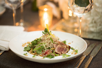 Close-up of beef and noodle salad with nuts on dinner plate, fine dining at restaurant, Canada 11030048699| 写真素材・ストックフォト・画像・イラスト素材|アマナイメージズ