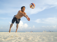 Man Playing Volleyball on Beach, Mexico