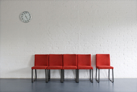 Red Chairs and Wall Clock