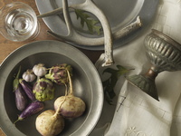 Overhead View of Turnips, Eggplants, Artichokes and Garlic in Bowl, Studio Shot