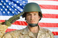 Soldier saluting in front of United States flag  (portrait 11044002361| 写真素材・ストックフォト・画像・イラスト素材|アマナイメージズ