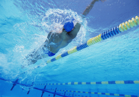 Young professional male athlete doing backstroke in swimming 11044024584| 写真素材・ストックフォト・画像・イラスト素材|アマナイメージズ