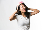 Chinese woman having fun with a princess crown